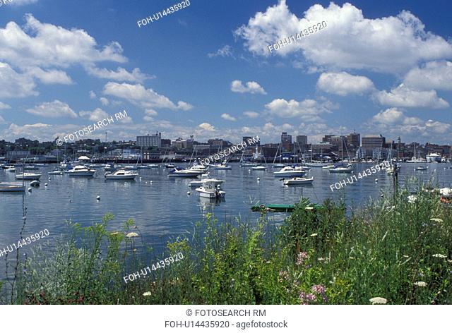 South Portland, ME, Maine, Boats buoyed in Portland Harbor on Casco Bay
