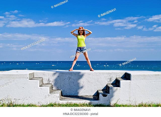 Blue sky, the sea and the woman
