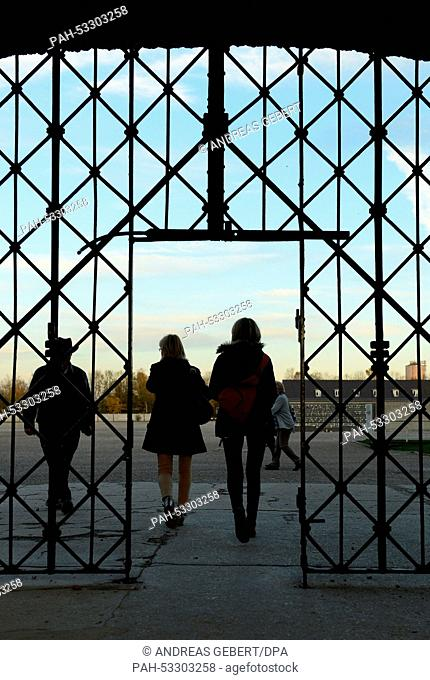 Two women walk through the main entrance of the concentration camp memorial in Dachau, Germany, 02 November 2014. Unidentified persons have stolen the door of...