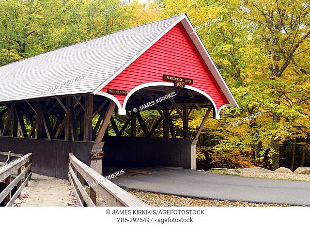 A covered bridge is the start of a hiking trail leading visitors to the Flume Gorge in Franconia Notch State Park, New Hampshire