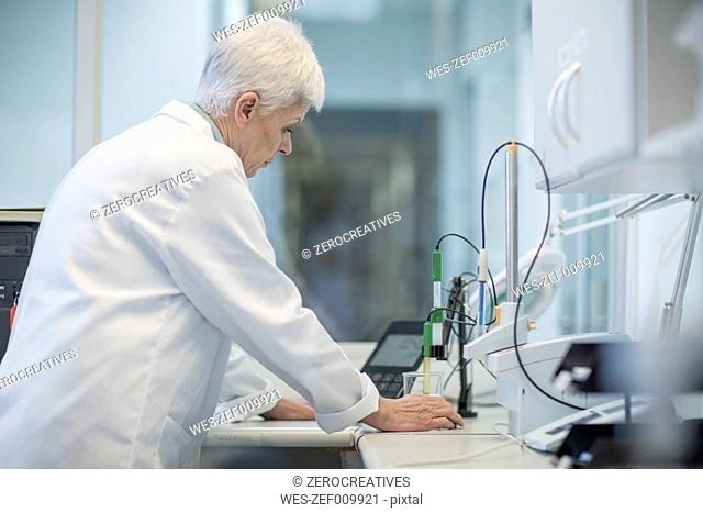 Senior woman working in lab