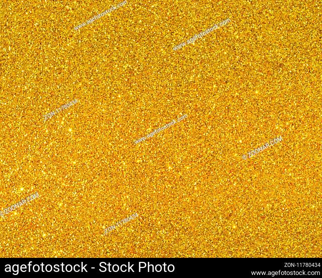 Detailed texture of glittering golden dust surface for Christmas