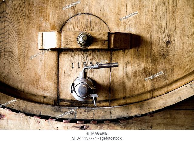 A wooden barrel with a metal tap