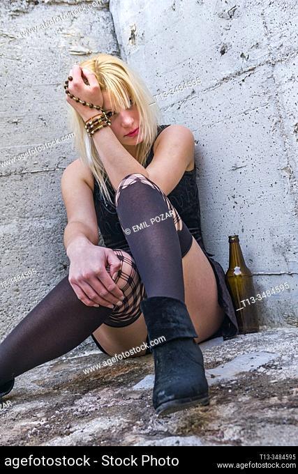 Abandoned young woman drinker
