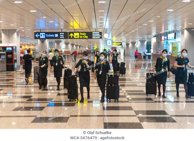 Singapore, Republic of Singapore, Asia - Upon their arrival at Changi Airport, flight attendants of the Taiwanese airline Eva Air wear protective masks to...
