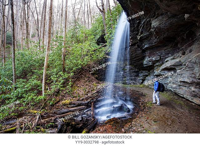 Hiker at Little Moore Cove Falls - Pisgah National Forest, Brevard, North Carolina, USA