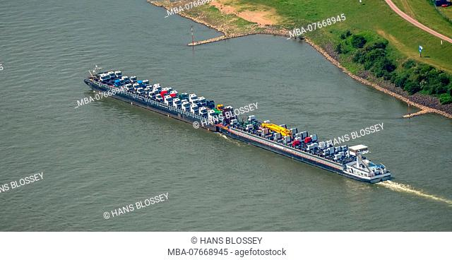 Aerial view, cargo ship on the Rhine going uphill, push boat with additional lighter, tractors and trucks are the freight, inland shipping Duisburg, Ruhrgebiet