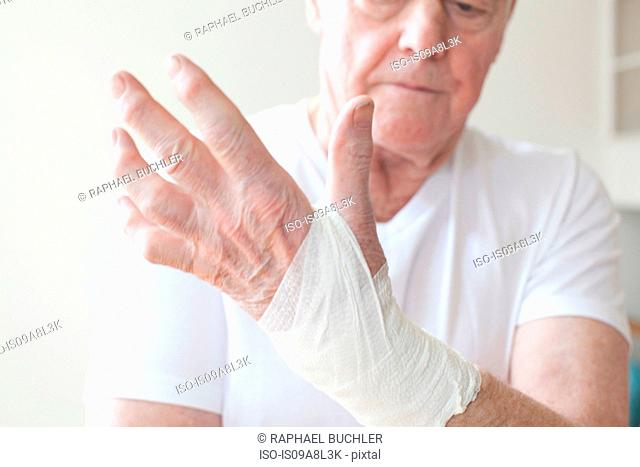 Senior man with bandage on wrist