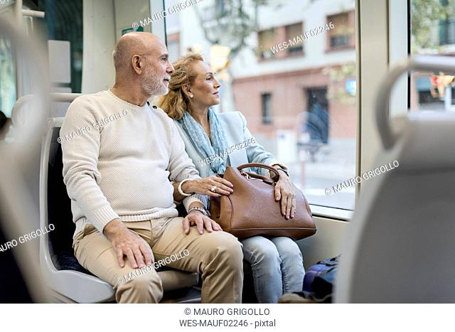 Senior couple sitting in a tram