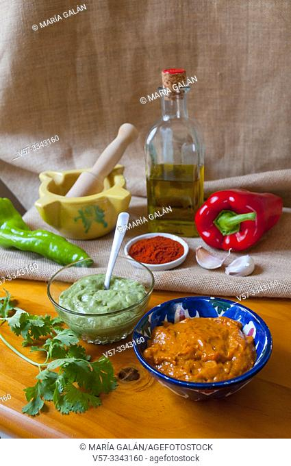 Mojo verde and mojo picon with ingredients. Canary Islands, Spain