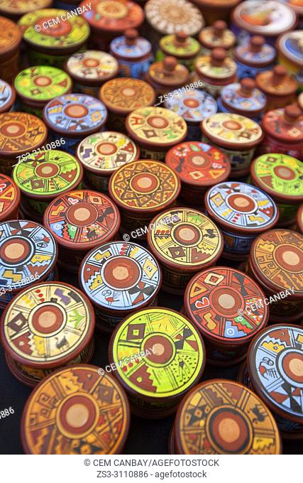 Close-up shot of of colorful wooden bowls and boxes at the open-air art and craft market in Pisac, Sacred Valley, Cusco Region, Peru, South America