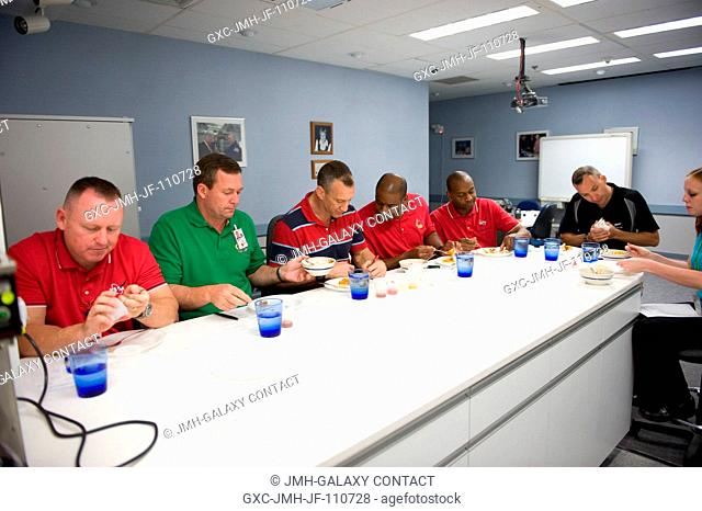 STS-129 crewmembers participate in a food tasting session in the Habitability and Environmental Factors Office at NASA's Johnson Space Center