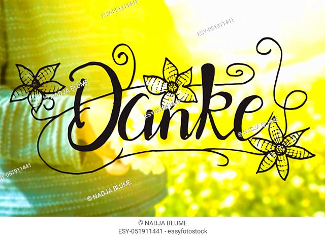 German Calligraphy Danke Means Thank You. Cute Little Kid Is Holding A Bouquet Of Daisy Flower. Sunny And Spring Flower Field