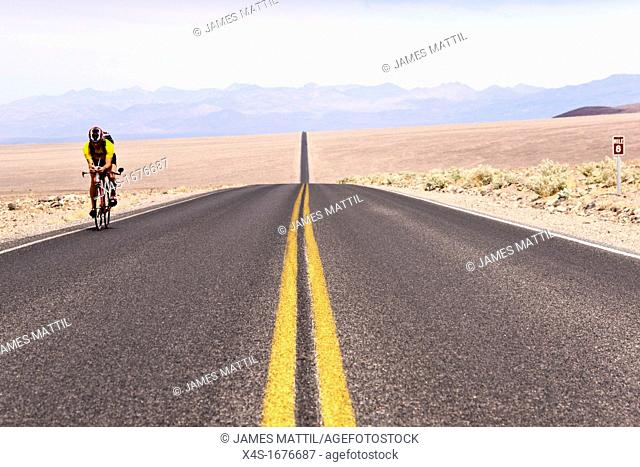 A lone cyclist rides through Death Valley National Park just before asking for a ride