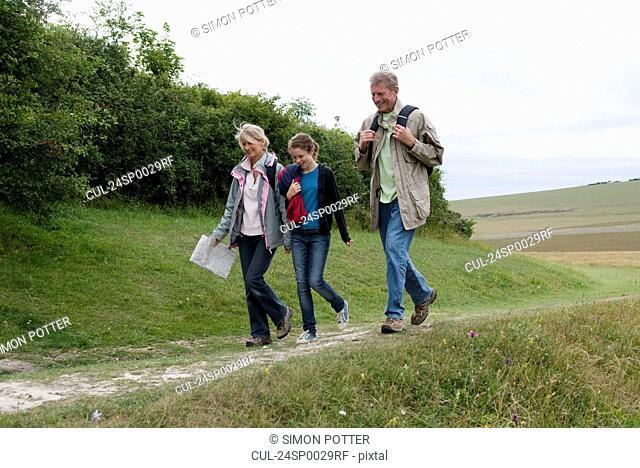 Seniors and grandchild on a hike