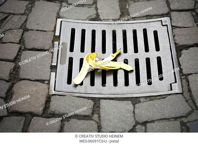 Banana peel on manhole cover, elevated view
