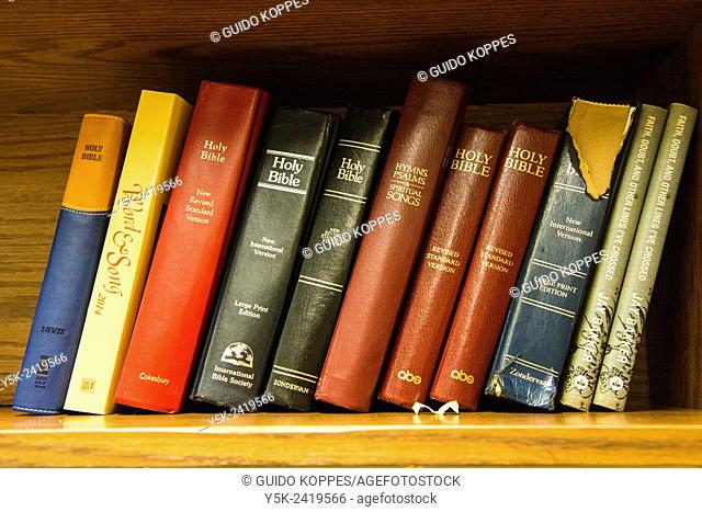 New York, USA. Bookshelf with Holy Bibles in the Upper West End Collegiate Church, Manhattan