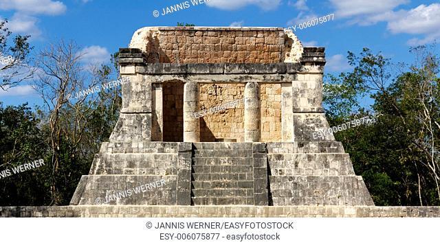 Ruined Mayan dais rises above the Juego de Pelota playing field at Chichen Itza, Yucatan, Mexico