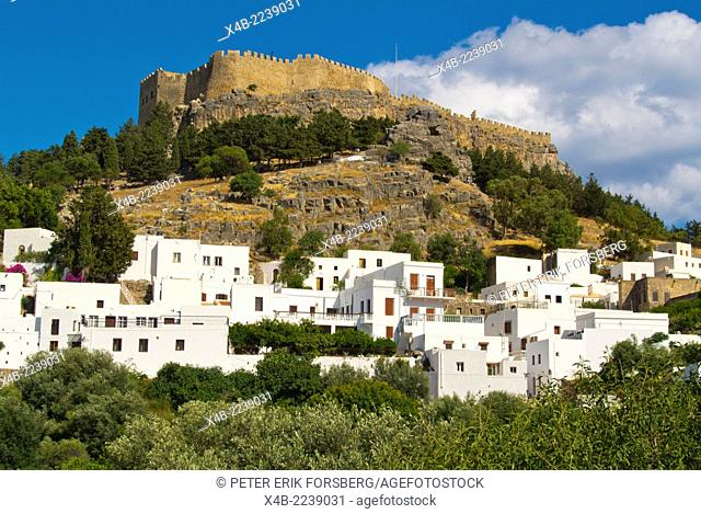Acropolis and castle and white washed residential buildings, Lindos town, Rhodes island, Dodecanese islands, Greece, Europe