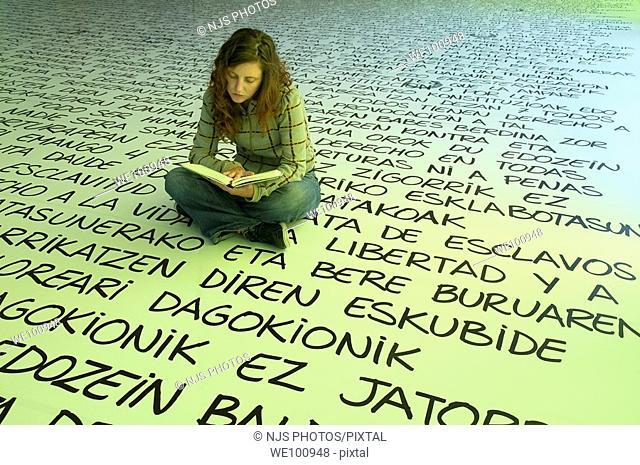Girl reading a book, Human Beings Exhibition in the Culture House, Aiete Park, Donostia-San Sebastián, Guipúzcoa, Basque Country, Spain