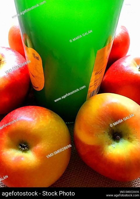 Cider bottle with apples. Asturias, Spain