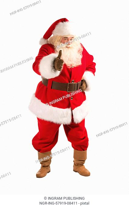 Happy Christmas Santa Claus showing thumb up. Isolated on white background. Full length