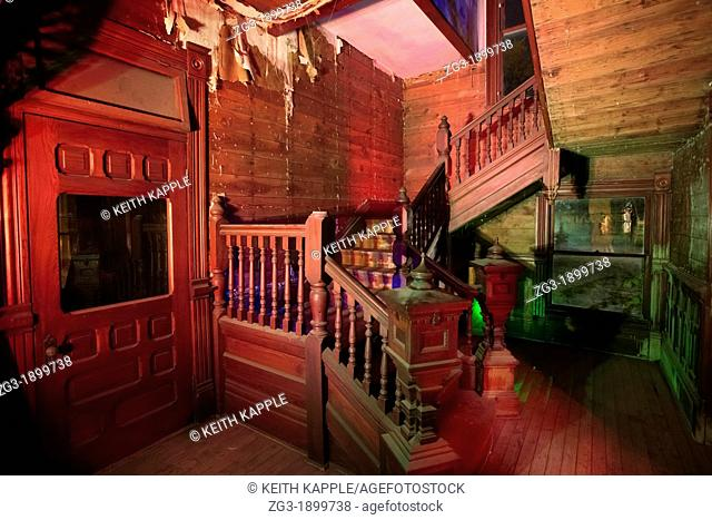 Light painting photograph of the Interior of an old staircase in an abandoned Victorian era home, 1887, Calvert, Texas