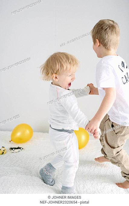 Boys playing with balloons