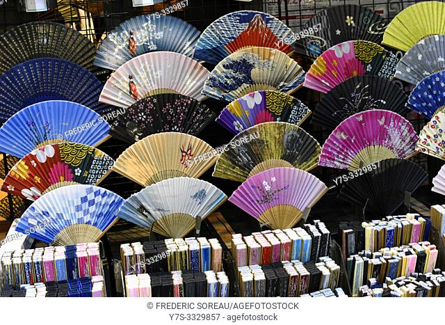 Shop window with traditional colorful hand fans and sandals in the Asakusa district of Tokyo, Japan, Asia