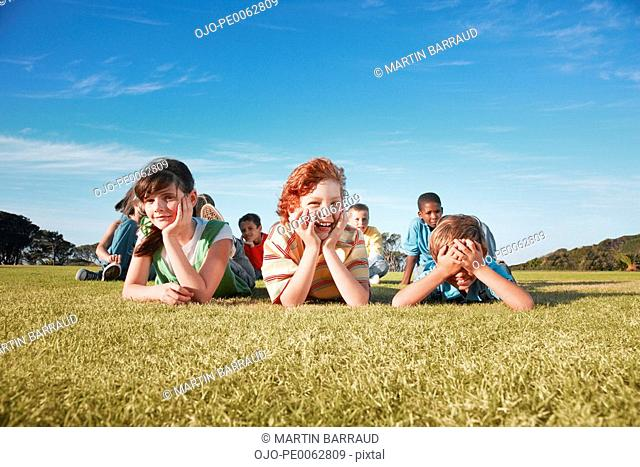 Group of children laying in field