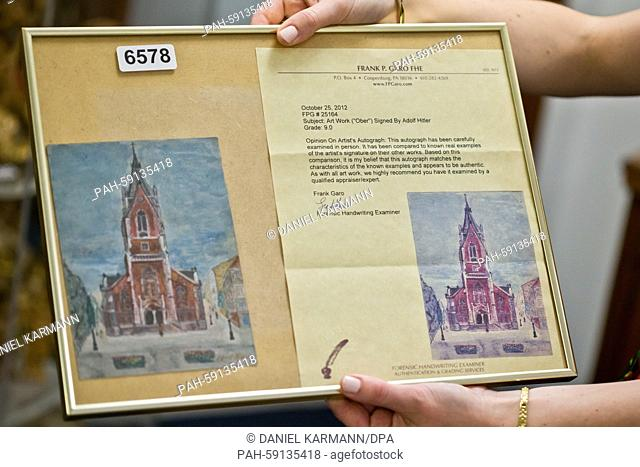The watercolour painting 'Kirche in Wien' (lit. Church in Vienna), which is attributed to Adolf Hitler, and an expertise are seen at an auction house in...
