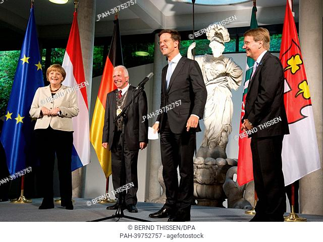 Dutch Prime Minister MarkRutte '(2-R) talks during a reception for first German-DutchCabinet Meeting with German Chancellor Angela Merkel (L-R)