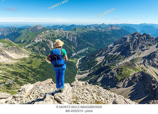 Hiker with views of mountains and Alps, view from the Hochvogel, right Kleiner Roßzahn, Allgäu, Allgäuer Hochalpen, Bavaria, Germany