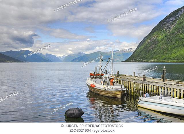 fisher boat with panorama of the Sognefjord and the surrounding mountains, Norway, landing stage of Vik i Sogn
