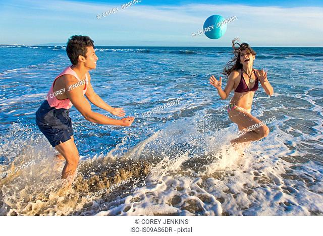 Young couple fooling around in sea
