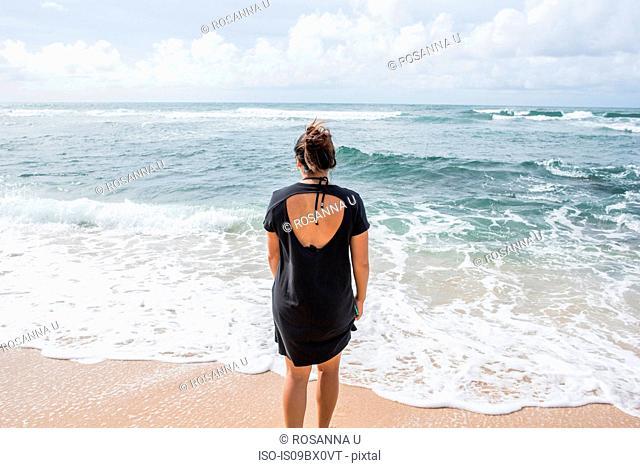 Woman looking out to sea, Kapaa Beach, Kauai, Hawaii
