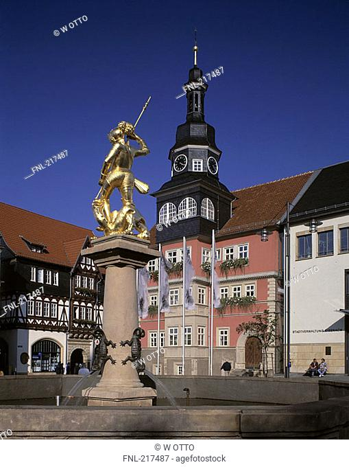 Georgsbrunnen fountain statue in front of city hall, St George Church, Eisenach, Thuringia, Germany