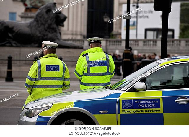 England, London, Trafalgar Square. Metropolitan Police officers and car on duty in central London