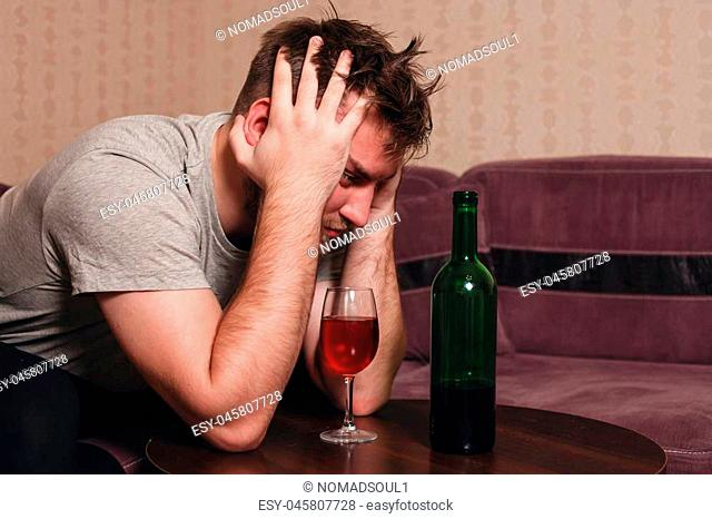 Stressed man after hard drinking. Alcohol abuse problem concept