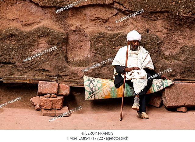 Ethiopia, Amhara region, Lalibela, The church Bet Emanuel listed as World Heritage by UNESCO, sitting orthodox priest