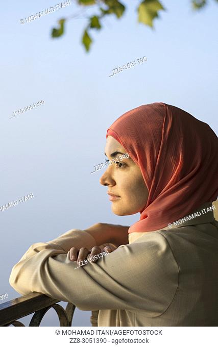 Side view portrait of a Muslim woman wearing Hijab looking away