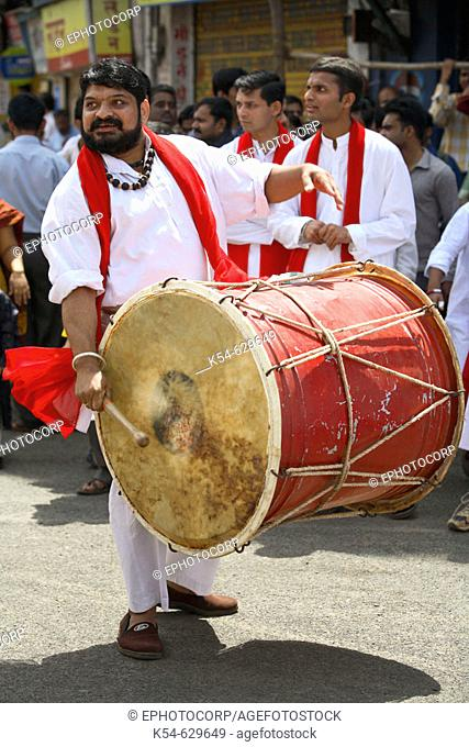 A man playing drum on the occasion of local festival, Pune, Maharashtra, India