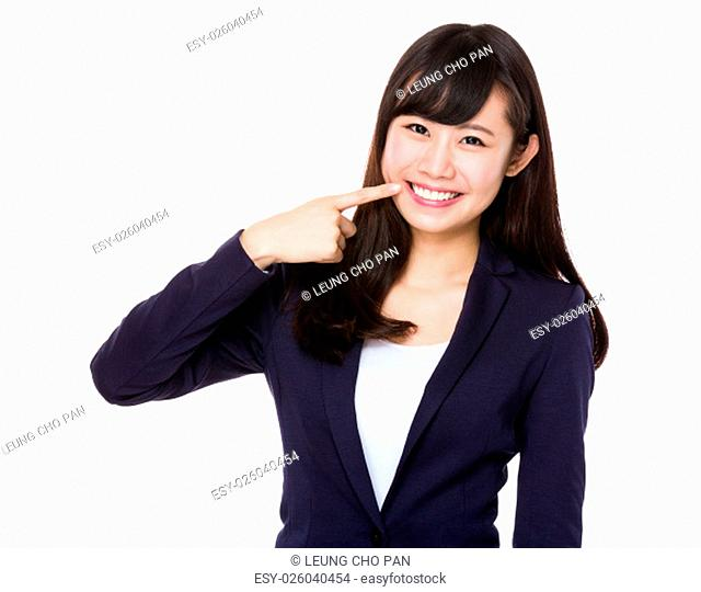 Young Businesswoman with finger point to her teeth