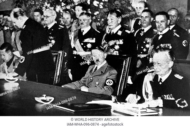 Galeazzo Ciano, Adolf Hitler and Joachim Von Ribbentrop at the signing of the Pact of Steel in the Reichskanzlei in Berlin 22 May 1939