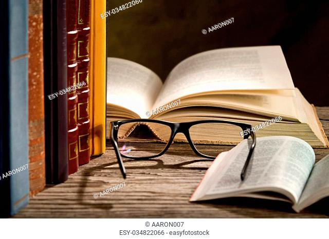 reading glasses with bokks on the table