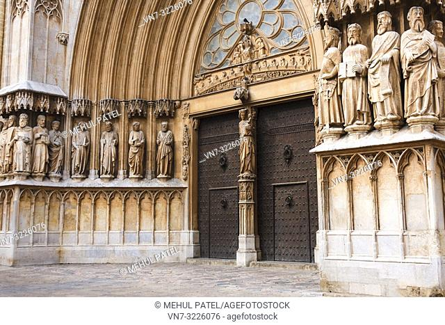 Main gate and facade of the Cathedral of Tarragona, Catalonia, Spain. The cathedral is situated in the old town of Tarragona at the city's highest point and was...