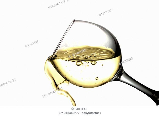 Yellow liquid, water, apple juice, white wine pouring into a glass, liquid in a speaker, isolated on a white background