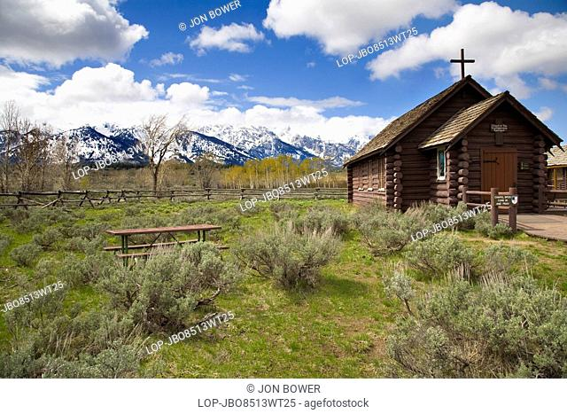 USA, Wyoming, Jackson Hole. A tiny church perched beneath the Grand Tetons