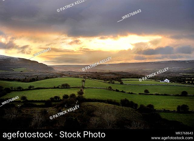Rolling green fields at sunset in the coastal town of Ballyvaughan, County Clare, Munster, Republic of Ireland, Europe