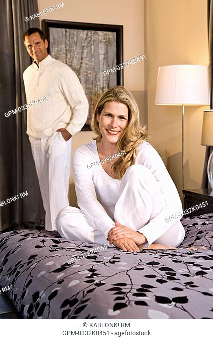 Portrait of mid adult couple relaxing in bedroom